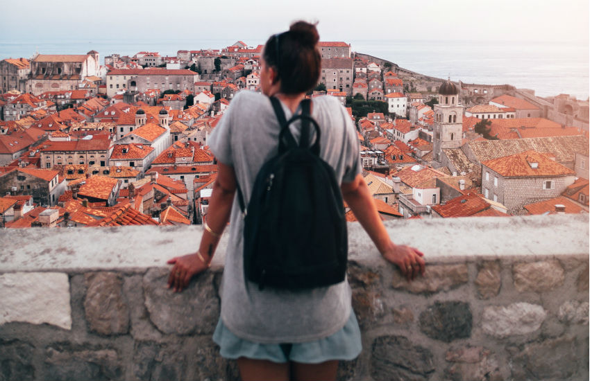Girl with Backpack in Kings Landing