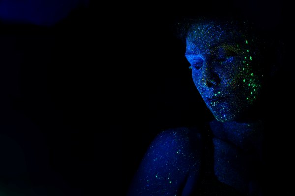 Woman with light display on skin