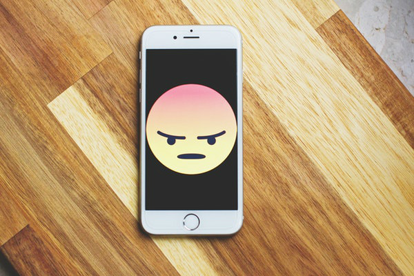 Unhappy Emoji phone