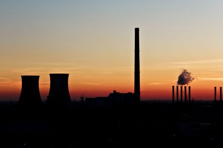 Factories silhouetted in dusk